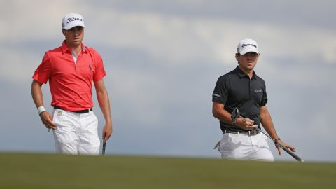 Koepka held off third-round leader Brian Harman (right), while Justin Thomas (left) faded after his US Open record low round in relation to par of nine-under 63 Saturday.