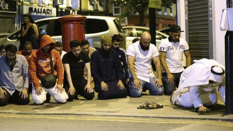 Locals pray near the mosque.