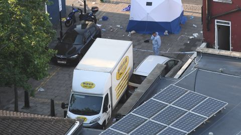A forensics officer stands next to a van near the Finsbury Park Mosque.