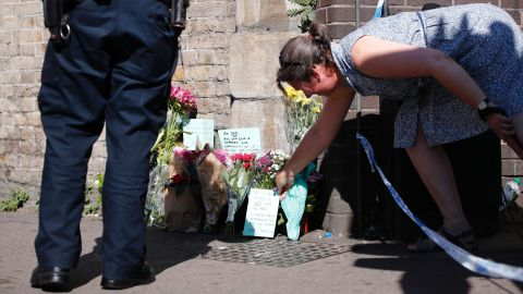 """A woman lays flowers near the scene where a van <a href=""""http://www.cnn.com/2017/06/18/europe/urgent---london-vehicle-collision/index.html"""" target=""""_blank"""">plowed into a crowd of pedestrians in north London</a> on Monday, June 19. A man was arrested, police said, and is being held on suspicion of terrorism offenses. The attack happened near a mosque, and British Prime Minister Theresa May said it was directed at Muslims."""