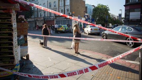 Pedestrians watch investigators at work.