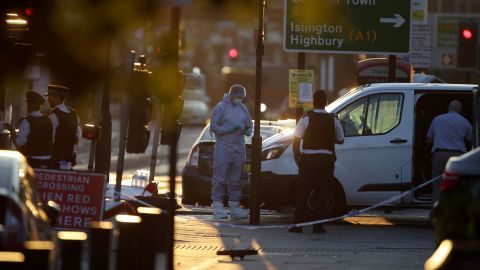 Investigators work at the scene.