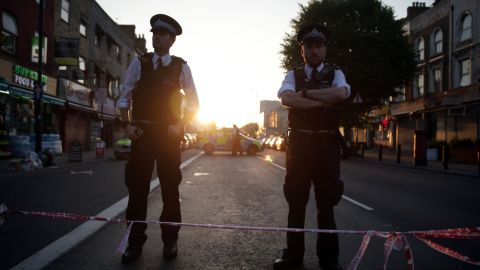 Police guard a street in the Finsbury Park area.