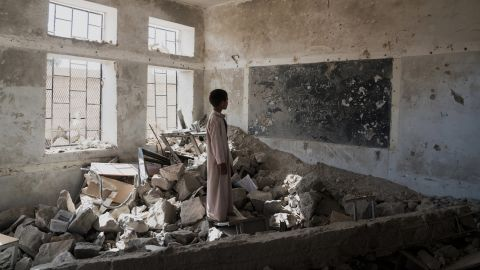 AAL OKAB SCHOOL , SAADA CITY, YEMEN - 24 APRIL 2017 A student at the Aal Okab school stands in the ruins of one of his former classrooms, which was destroyed during the conflict in June 2015. Students now attend lesson in UNICEF tents nearby.Giles Clarke/UN OCHA