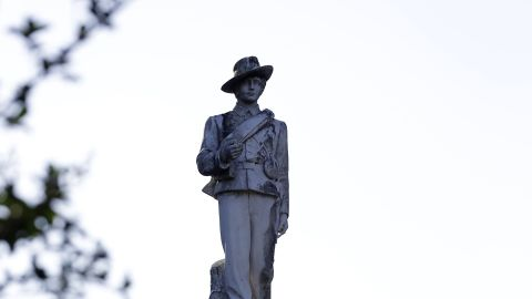A statue of a Confederate soldier constructed in 1911 in displayed in a downtown park and will be moved to a nearby cemetery after it was decided in a hearing with supporters and protestors of the statue, Tuesday, May 16, 2017, in Orlando, Fla. (AP Photo/John Raoux)