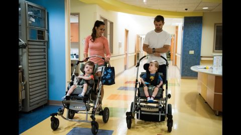 Nicole McDonald pushes a stroller with Anias as her husband Christian pushes Jadon down a hallway on June 14 at Blythedale Children's Hospital in Valhalla, New York, where the boys have been rehabilitating.