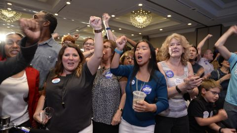 People celebrating at the Jon Ossoff election party