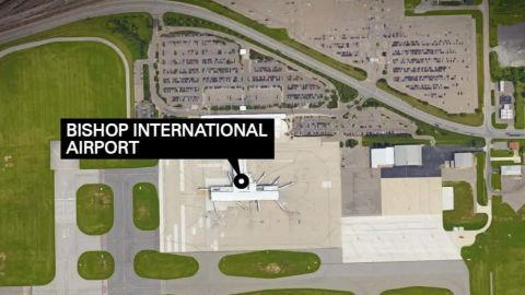 officer stabbed in neck at michigan airport ath _00003720.jpg