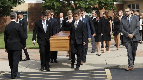 Pallbearers carry Otto Warmbier's casket from  Wyoming High School on Thursday.