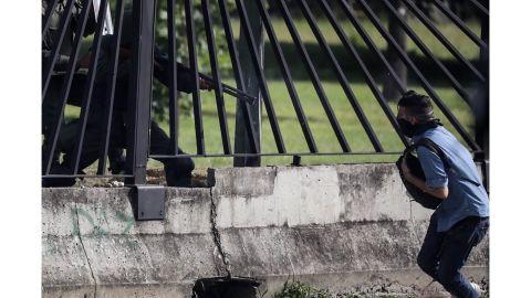 David José Vallenilla, 22, is shot during a protest Thursday outside La Carlota airbase in Caracas.