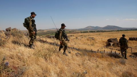 """Israeli soldiers patrol near the border with Syria after projectiles fired from the war-torn country hit the Israeli occupied Golan Heights on June 24, 2017. An Israeli aircraft carried out a strike on Syria after 10 projectiles hit the occupied Golan Heights, an army spokesman said. The Israeli Air Force also targeted two tanks of the """"Syrian regime"""" in the northern part of the Golan, the spokesman said, adding the projectiles did not cause any casualties."""