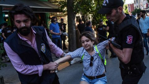 ISTANBUL, TURKEY - JUNE 25:  A woman is arrested by police after gathering to support the LGBT Pride March on June 25, 2017 in Istanbul, Turkey. The 2017 LGBT Pride March was banned by authorities for the third year. Organisers defied the order and people attempted to march to Taksim Square but were met by a heavy police presence and the crowd was dispersed by tear gas and several people were arrested.  (Photo by Chris McGrath/Getty Images)