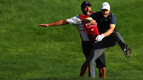 Jordan Spieth (right) and caddie Michael Greller celebrate after the US golfer holed a bunker shot to win the Travelers Championship.