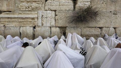 Jewish people wearing prayer shawls take part in the Cohanim prayer (priest's blessing)