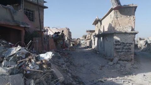 Drone footage shows devastation within Mosul as civilians flee the ongoing battles.