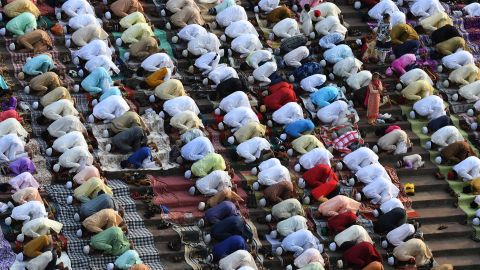 Indian Muslims offer prayers during Eid al-Fitr at the Jama Masjid mosque in New Delhi on June 26, 2017.