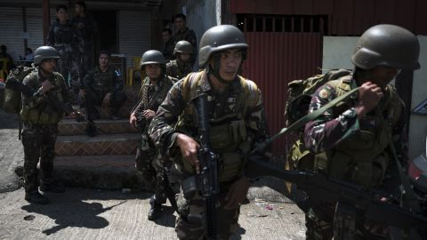 """MARAWI CITY, PHILIPPINES - JUNE 03:  Soldiers being deployed to the frontine insdie the city being sieged by militants are transported to safer grounds, on June 3, 2017 in Marawi City, southern Philippines. At least 182 residents trapped between gun battles between government troops and ISIS-linked militants were rescued by a team of civilian rescuers on Friday. Residents recounted their harrowing ordeal in surviving for more than a week while trying to escape without being killed by crossfire. Filipino officials announced on Thursday the death toll during the fighting at Malawi City to have risen to 129, with 89 extremists among the dead and 1,000 civilians remaining trapped in the southern city during the 10th day of the crisis. Ten soldiers have reportedly been killed and several were wounded during """"friendly fire"""" on Thursday when Philippine's air force dropped bombs on Islamic extremists while government forces struggle to end the siege, the military said Thursday. According to reports, the terror groups started taking hostages, including a roman catholic priest, among the 1,000 residents stranded and around 85,000 people had been forced to seek refuge at evacuation centers around Marawi. President Rodrigo Duterte declared martial law in Mindanao after militants Maute Group and Abu Sayyaf rampaged through Marawi city, which is home to some 200,000 people. (Photo by Jes Aznar/Getty Images)"""