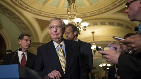WASHINGTON, DC : (L to R) Senate Majority Leader Mitch McConnell (R-KY) listens to a question during a press conference after a closed-door Senate GOP conference meeting on Capitol Hill, June 27, 2017 in Washington, DC. The Senate GOP announced they will delay a vote on their health care bill until after the July 4 recess. (Drew Angerer/Getty Images)