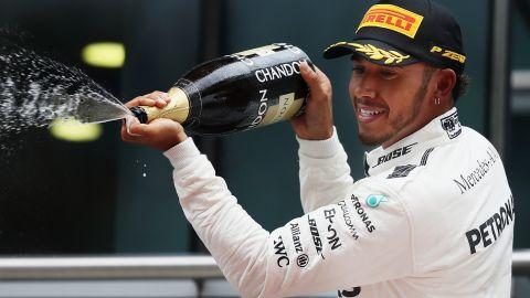 Hamilton celebrates his win in Shanghai this April.