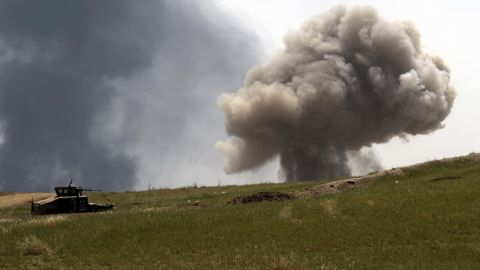 A smoke cloud rises on the front line as the Iraqi Emergency Response Division advances in west Mosul on Saturday, May 6.