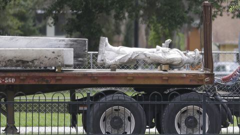 """The top section of a Confederate statue called """"Johnny Reb"""" is loaded on a truck before being removed from a downtown park Tuesday, June 20, 2017, in Orlando, Fla. The statue will be relocated to a Confederate section of a nearby cemetery."""