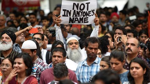 Citizens and celebrities hold signs at the New Delhi protest.