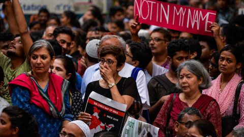 Indian protesters hold placards in New Delhi.