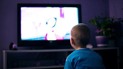 Boy watching television in dark living room; Shutterstock ID 656496229; PO: CNN Photos