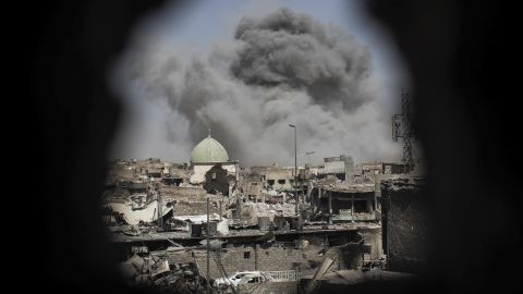 A bomb explodes near the al-Nuri mosque complex on Thursday, June 29. Iraq's military has seized the remains of the Great Mosque of al-Nuri. Iraq and the United States have accused ISIS of blowing up the historic mosque.