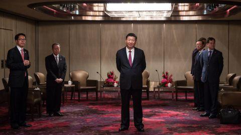 China's President Xi Jinping, center, waits to meet with Hong Kong's chief executive Leung Chun-ying at a hotel in Hong Kong on June 29.