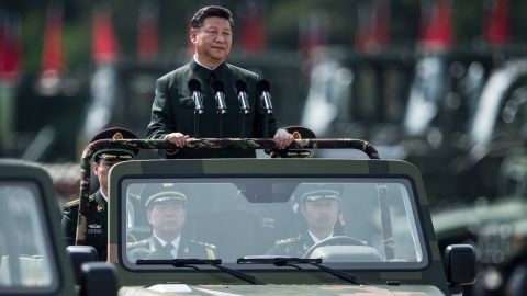 China's President Xi Jinping inspects People's Liberation Army soldiers at a barracks in Hong Kong on June 30.
