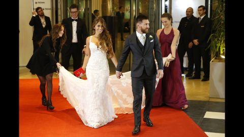 ROSARIO, ARGENTINA - JUNE 30:  Lionel Messi and Antonela Rocuzzo pose for pictures during Lionel Messi and Antonela Rocuzzo's Wedding at City Center Hotel on June 30, 2017 in Rosario, Argentina. (Photo by Gabriel Rossi/LatinContent/Getty Images)