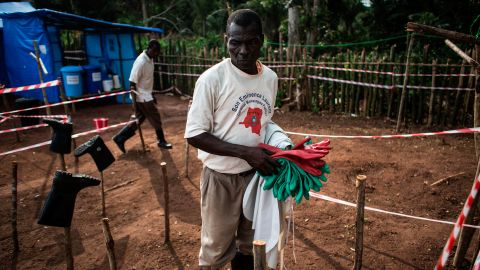 A health worker cleans equipment at an Ebola quarantine unit in Muma, DRC, after a case of Ebola was confirmed in the village.