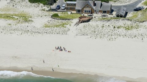 """New Jersey Gov. Chris Christie uses the beach with his family and friends at the governor's summer house at Island Beach State Park in New Jersey on July 2. Christie is defending his use of the beach, closed to the public during New Jersey's government shutdown, saying he had previously announced his vacation plans and the media had simply """"caught a politician keeping his word."""""""