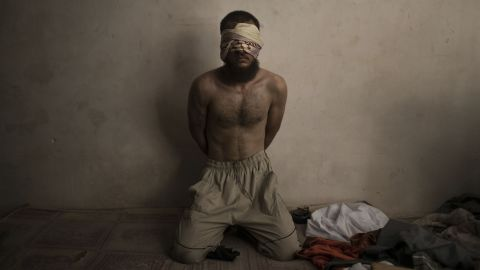 A suspected ISIS fighter is held in a basement while Iraqi forces continue to push for control of the Old City of Mosul on Monday, July 3.