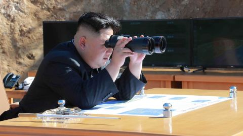 """This picture taken and released on July 4, 2017 by North Korea's official Korean Central News Agency (KCNA) shows North Korean leader Kim Jong-Un inspecting the test-fire of intercontinental ballistic missile Hwasong-14 at an undisclosed location. North Korea declared on July 4 it had successfully tested its first intercontinental ballistic missile -- a watershed moment in its push to develop a nuclear weapon capable of hitting the mainland United States. / AFP PHOTO / KCNA VIA KNS / STR / South Korea OUT / REPUBLIC OF KOREA OUT   ---EDITORS NOTE--- RESTRICTED TO EDITORIAL USE - MANDATORY CREDIT """"AFP PHOTO/KCNA VIA KNS"""" - NO MARKETING NO ADVERTISING CAMPAIGNS - DISTRIBUTED AS A SERVICE TO CLIENTS THIS PICTURE WAS MADE AVAILABLE BY A THIRD PARTY. AFP CAN NOT INDEPENDENTLY VERIFY THE AUTHENTICITY, LOCATION, DATE AND CONTENT OF THIS IMAGE. THIS PHOTO IS DISTRIBUTED EXACTLY AS RECEIVED BY AFP.   / STR/AFP/Getty Images"""