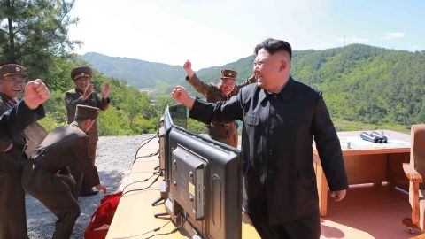 """This picture taken and released on July 4, 2017 by North Korea's official Korean Central News Agency (KCNA) shows North Korean leader Kim Jong-Un (R) reacting after the test-fire of the intercontinental ballistic missile Hwasong-14 at an undisclosed location. North Korea declared on July 4 it had successfully tested its first intercontinental ballistic missile -- a watershed moment in its push to develop a nuclear weapon capable of hitting the mainland United States. / AFP PHOTO / KCNA VIA KNS / STR / South Korea OUT / REPUBLIC OF KOREA OUT   ---EDITORS NOTE--- RESTRICTED TO EDITORIAL USE - MANDATORY CREDIT """"AFP PHOTO/KCNA VIA KNS"""" - NO MARKETING NO ADVERTISING CAMPAIGNS - DISTRIBUTED AS A SERVICE TO CLIENTS THIS PICTURE WAS MADE AVAILABLE BY A THIRD PARTY. AFP CAN NOT INDEPENDENTLY VERIFY THE AUTHENTICITY, LOCATION, DATE AND CONTENT OF THIS IMAGE. THIS PHOTO IS DISTRIBUTED EXACTLY AS RECEIVED BY AFP.   / STR/AFP/Getty Images"""