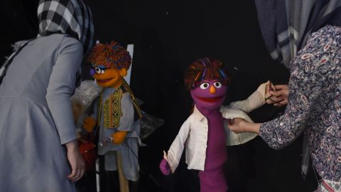 Afghan puppeteers dress Muppets Zeerak, left, and his sister Zari at a television studio in Kabul.