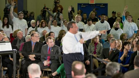 """Demonstrators stand with the word """"Bridgegate"""" spelled out on their shirts during a town-hall event in Flemington, New Jersey, in March 2014."""