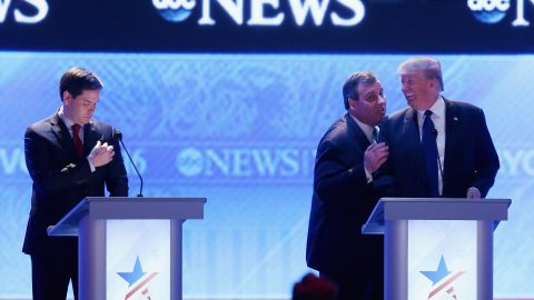 """Christie visits with fellow presidential candidate Donald Trump during a commercial break of a Republican debate in February 2016. From the debate's outset, Christie pestered US Sen. Marco Rubio, left. His relentless attack against Rubio, who was surging in the polls, was one of <a href=""""http://www.cnn.com/2016/02/07/politics/republican-debate-takeaways/index.html"""" target=""""_blank"""">the memorable takeaways of the night. </a>"""