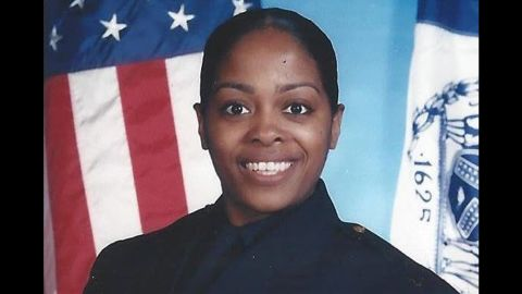Miosotis Familia, 48, was shot in the head shortly after midnight while she and her partner were sitting in a marked police vehicle. She was taken to St. Barnabas Hospital, where she died, the New York Police Department said.