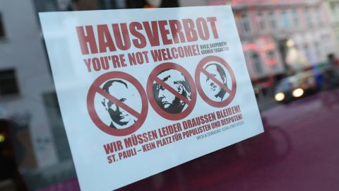 HAMBURG, GERMANY - JULY 05:  A sign in the window of a bar shows the faces of Russian President Vladimir Putin, U.S. President Donald Trump and Turkish President Recep Tayyip Erdogan crossed out ahead of Friday and Saturday's G20 summit on July 5, 2017 in Hamburg, Germany. Authorities are bracing themselves for protests as world leaders including Donald Trump, Vladimir Putin and Recep Tayyip Erdogan are due to arrive in the city for the summit.  (Photo by Sean Gallup/Getty Images)