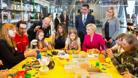 """Trump, seated fourth from left, plays with children during a July visit to the Copernicus Science Centre in Warsaw, Poland. She was joined by Polish first lady Agata Kornhauser-Duda, who is in the pink jacket. The Trumps <a href=""""http://www.cnn.com/2017/07/06/politics/gallery/trump-poland-germany/index.html"""" target=""""_blank"""">were visiting Poland</a> ahead of a G20 summit in Germany."""