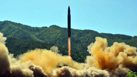 """TOPSHOT - This picture taken on July 4, 2017 and released by North Korea's official Korean Central News Agency (KCNA) on July 5, 2017 shows the successful test-fire of the intercontinental ballistic missile Hwasong-14 at an undisclosed location.South Korea and the United States fired off missiles on July 5 simulating a precision strike against North Korea's leadership, in response to a landmark ICBM test described by Kim Jong-Un as a gift to """"American bastards"""". / AFP PHOTO / KCNA VIA KNS / STR / South Korea OUT / REPUBLIC OF KOREA OUT   ---EDITORS NOTE--- RESTRICTED TO EDITORIAL USE - MANDATORY CREDIT """"AFP PHOTO/KCNA VIA KNS"""" - NO MARKETING NO ADVERTISING CAMPAIGNS - DISTRIBUTED AS A SERVICE TO CLIENTSTHIS PICTURE WAS MADE AVAILABLE BY A THIRD PARTY. AFP CAN NOT INDEPENDENTLY VERIFY THE AUTHENTICITY, LOCATION, DATE AND CONTENT OF THIS IMAGE. THIS PHOTO IS DISTRIBUTED EXACTLY AS RECEIVED BY AFP.  /         (Photo credit should read STR/AFP/Getty Images)"""