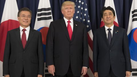US President Donald Trump (C), Japanese Prime Minister Shinzo Abe (R) and South Korean President Moon Jae-in pose for photos before attending the Northeast Asia Security Dinner at the US Consulate General Hamburg on the sidelines of the G20 Summit in Hamburg, Germany, July 6, 2017. (SAUL LOEB/AFP/Getty Images)