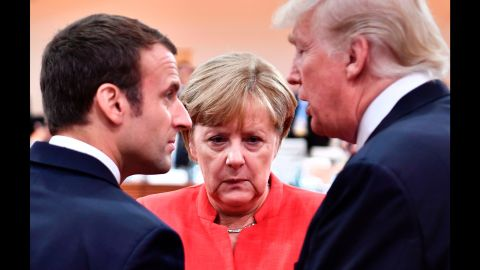 Macron, Merkel and Trump confer at the start of the first working session of the G20 summit.