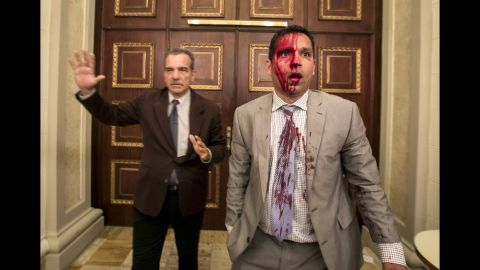 """Venezuelan lawmakers Luis Stefanelli, left, and Jose Regnault appear stunned in a corridor of the National Assembly after <a href=""""http://www.cnn.com/2017/07/05/americas/venezuela-indepedence-day-clashes/index.html"""" target=""""_blank"""">a clash with demonstrators</a> in Caracas on Wednesday, July 5. Supporters of Maduro stormed the building and attacked opposition lawmakers, witnesses said. At least seven legislative employees and five lawmakers were injured, according to National Assembly President Julio Borges. Journalists said they were also assaulted."""