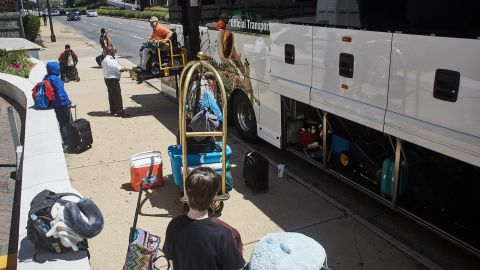 SLIC assistant director Rocky Fuselier boards the bus in a wheel chair.