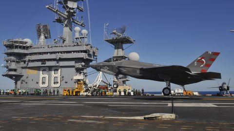 An F/A-18E Super Hornet prepares for takeoff from the flight deck of the USS Nimitz (CVN 68) aircraft carrier.