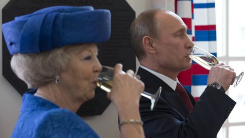 Putin and Dutch Queen Beatrix share a toast after unveiling a plaque at the Hermitage Amsterdam museum in April 2013. It's a branch of the Hermitage Museum in St. Petersburg.